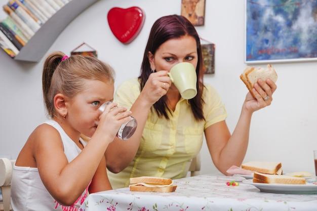 Woman and girl having breakfast