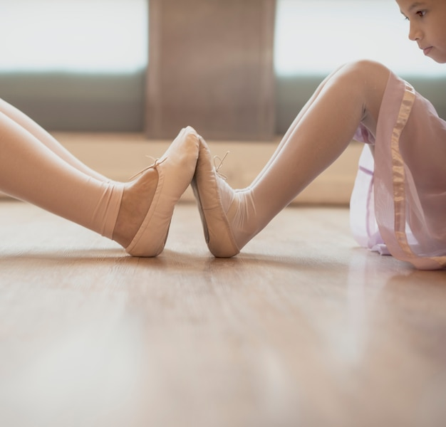 Woman and girl practising ballet