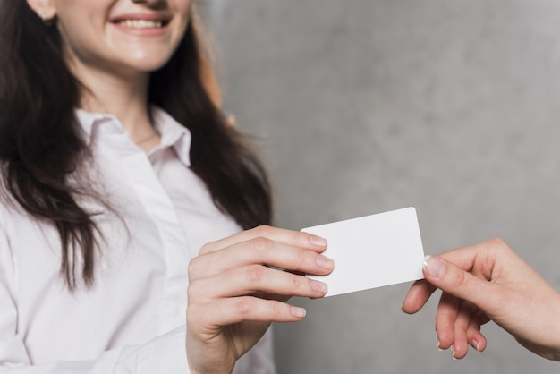 Woman giving business card to potential employee