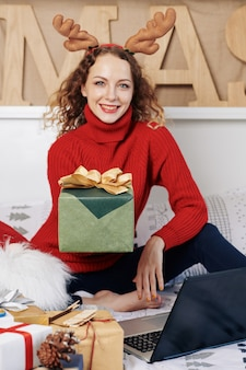 Woman giving christmas present
