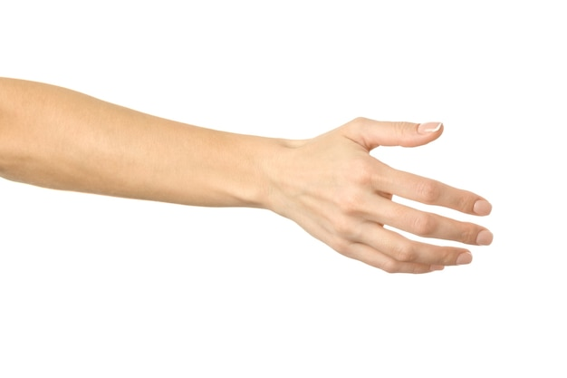 Woman giving hand for handshake isolated on white
