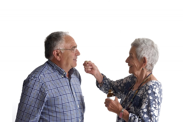 A woman giving her partner medication