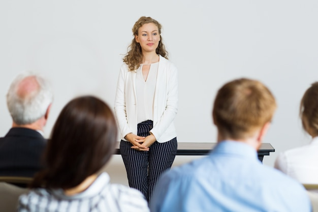 Woman giving a lecture to an audience