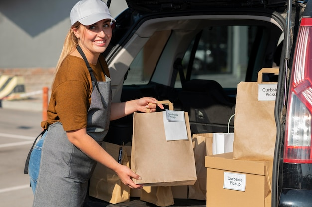 Woman giving an order at a curbside pickup outdoors
