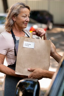 Woman giving an order at a curbside pickup