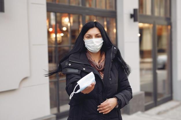 Woman giving protective mask