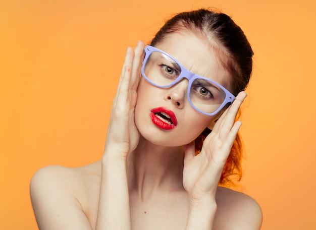 Woman glasses bright yellow orange space