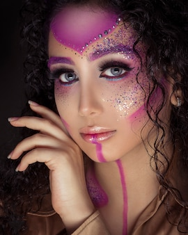 Woman in glittering pink makeup