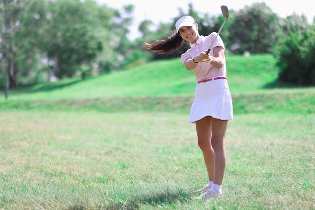 Woman golfer makes hit with golf club