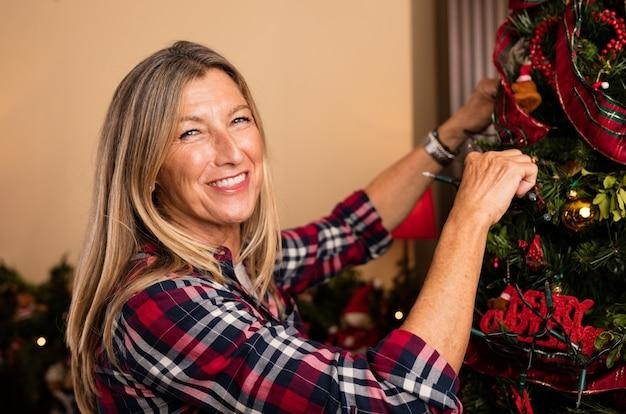 Woman gracing christmas tree