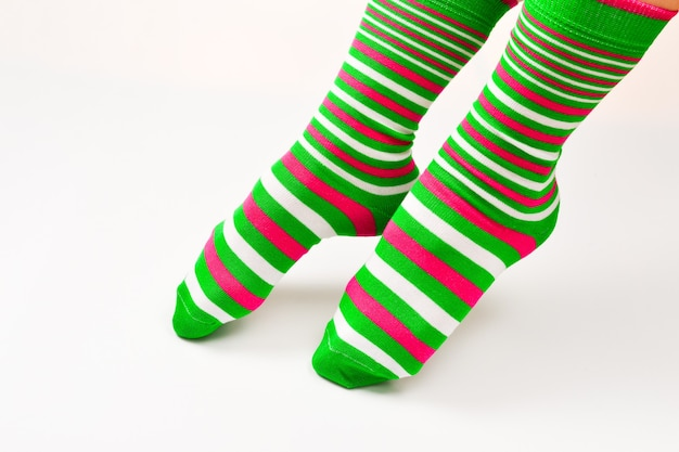 Woman in green socks isolated on white background. top view.