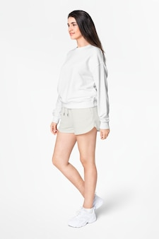 Woman in green sweater and shorts casual apparel