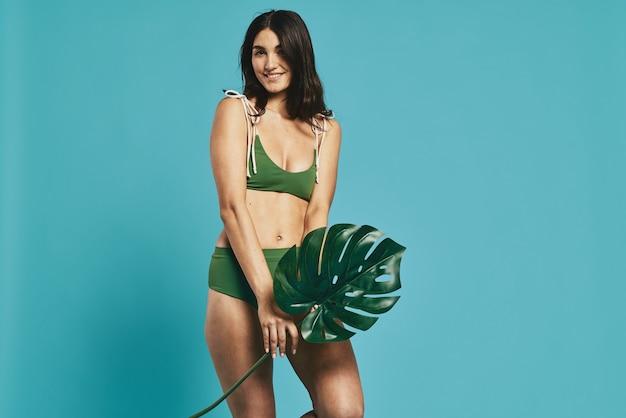 Woman in green swimwear beach bag posing fashion summer