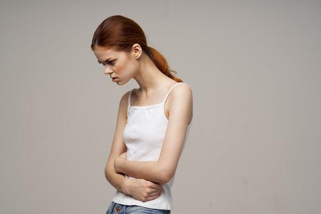 Woman groin pain intimate illness gynecology discomfort light background