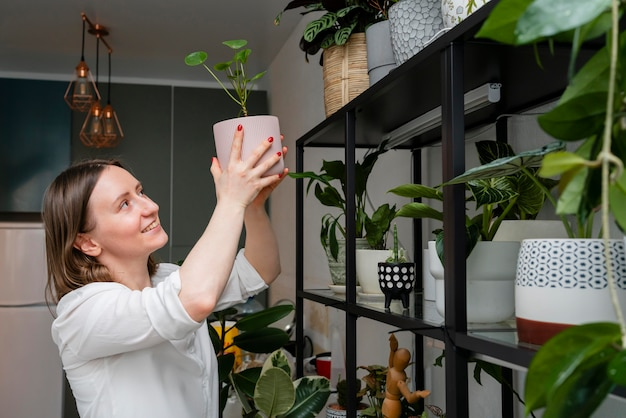 Woman growing plants at home
