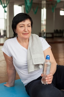 Woman at gym resting