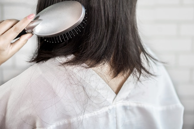 Woman hair loss after using hairbrush