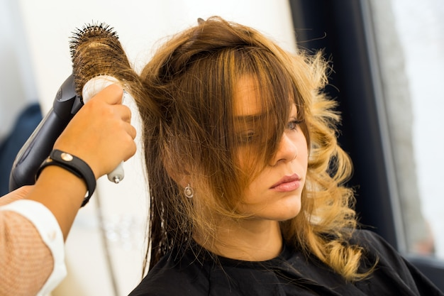 Woman at the hairdresser salon