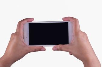 女性の手とスマートフォン