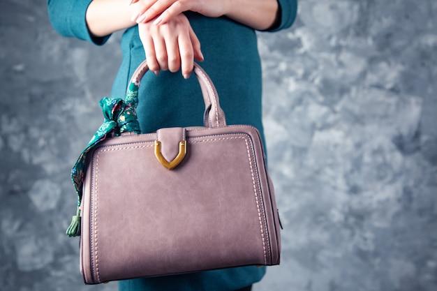 Woman hand bag on dark background
