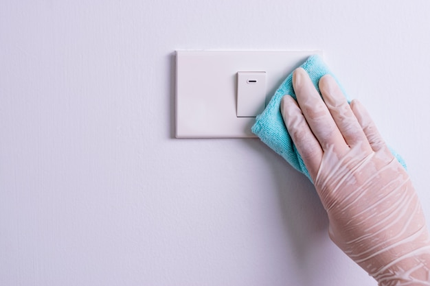 Woman hand to clean light switches
