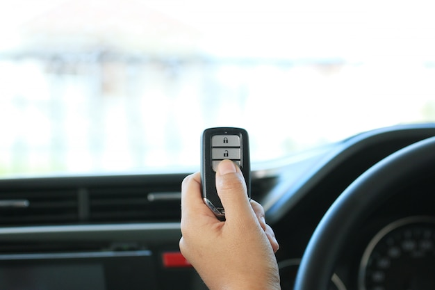 Woman hand hold a remote key car