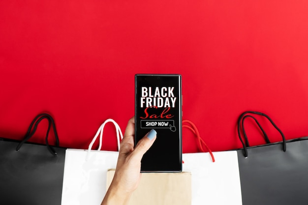 Woman hand hold smartphone for black friday online shopping