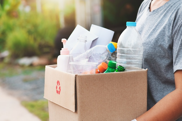 Woman hand holdging box garbage for recycle