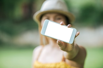 Woman hand holding cellphone, smartphone with white screen