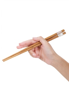 Woman hand holding chopsticks isolated on white