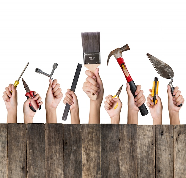 Woman hand holding a collection of diy tools set with wooden isolated on white