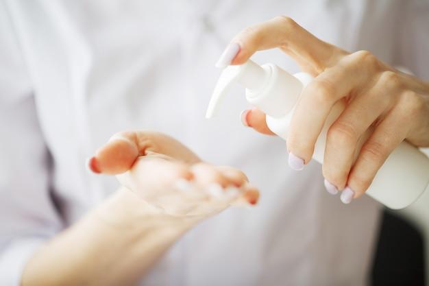 Woman hand holding cream