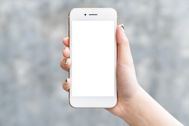 Woman hand holding mockup smartphone isolated white screen for app design or display