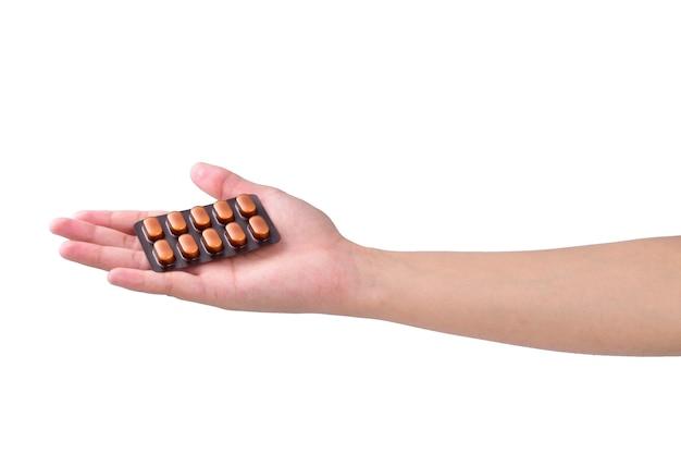 Женщина рука пакет медицины, изолированные на белом фоне