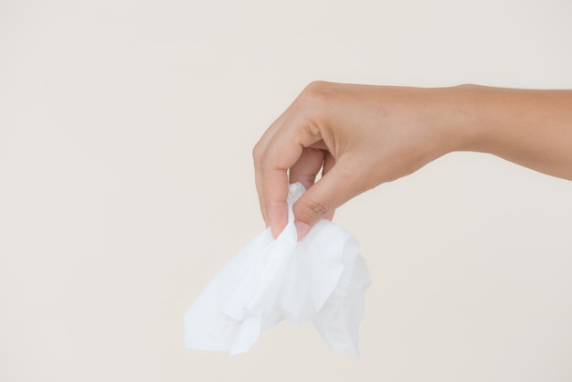 Woman hand holding or picking white tissue paper.