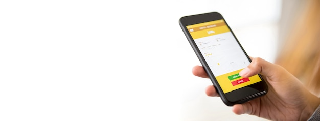 Woman hand holding smartphone booking hotel online via application