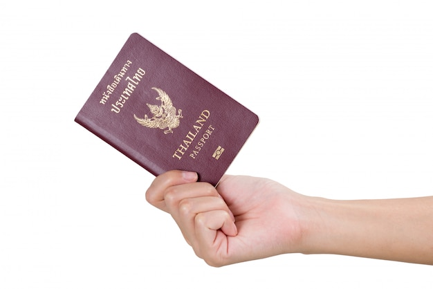Woman hand holding thai passport isolated on white