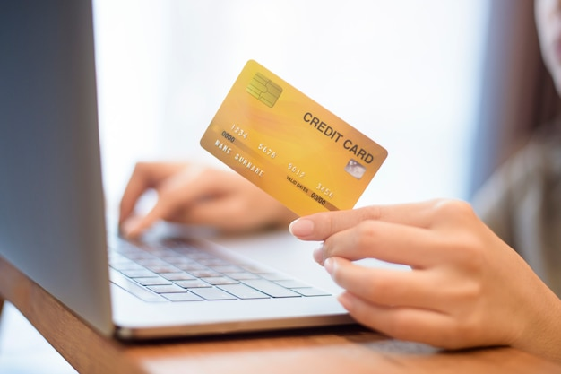 Woman hand is holding credit card