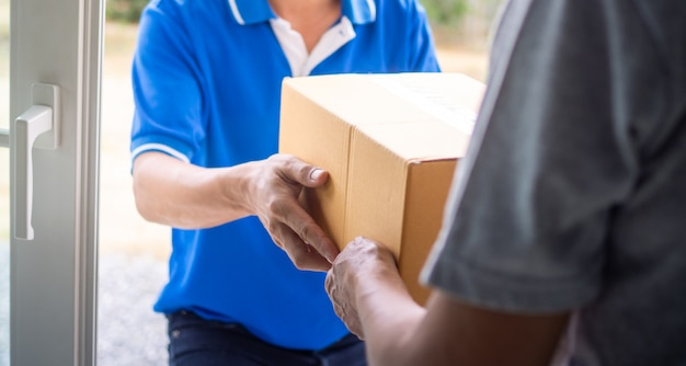 Woman hand pick up the delivery box from deliveryman
