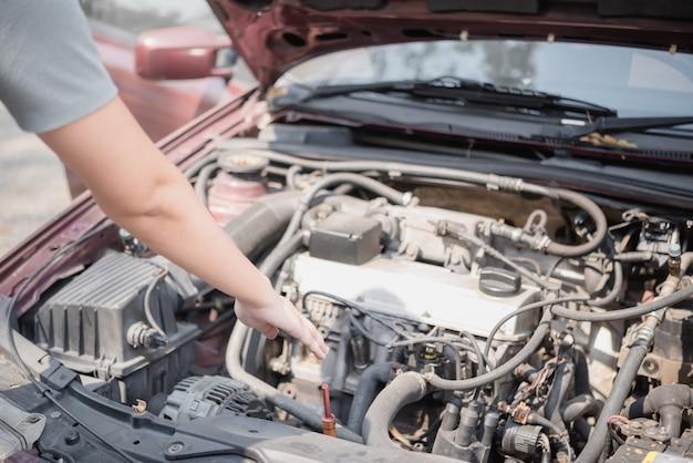 Woman hand repairs car