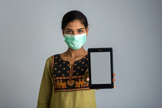 Premium Photo Woman Hand Showing Smart Mobile Phone With Safety Medical Face Mask Health Care And Infection Concept