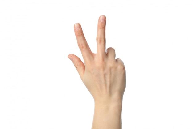 흰색 배경에 고립 된 세 손가락을 보여주는 여자 손
