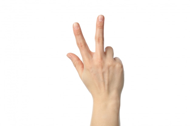 Woman hand showing three fingers, isolated on white background