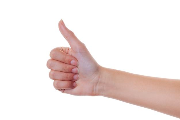 Рука женщины показывает большой палец вверх жест изолированный на белизне.