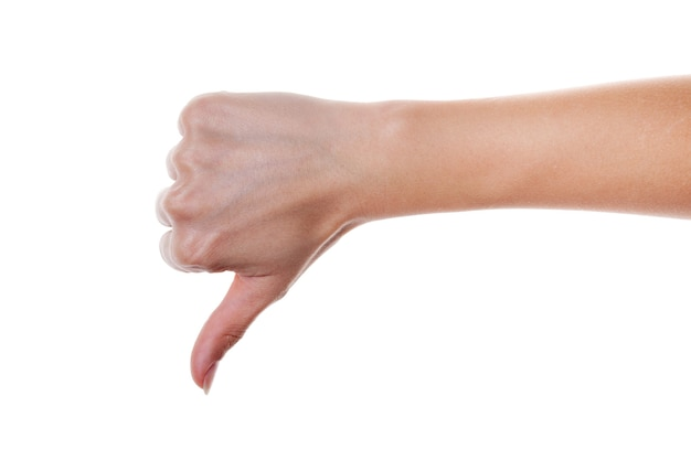 Woman hand shows thumb up gesture isolated on white.
