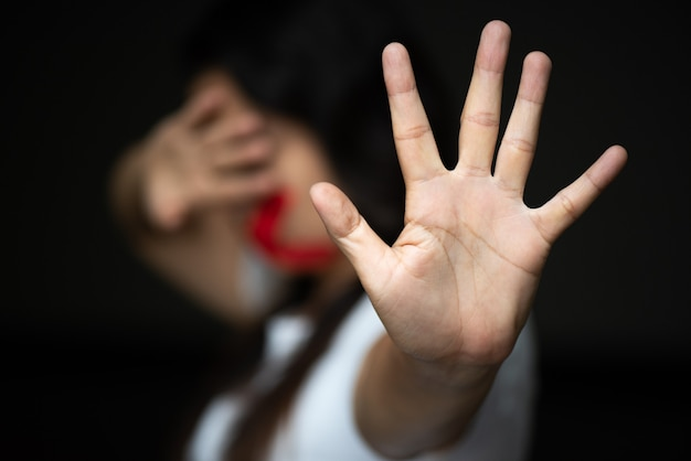 Woman hand sign for stop, abusing violence. human rights day concept.