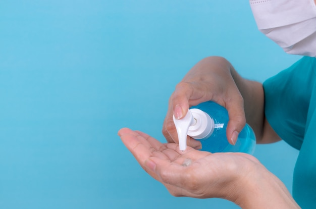 Woman hand take cleaner  from alcohol sanitizer bottle.