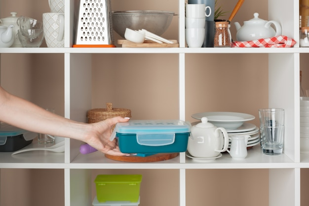 Woman hand taking dishware pieces