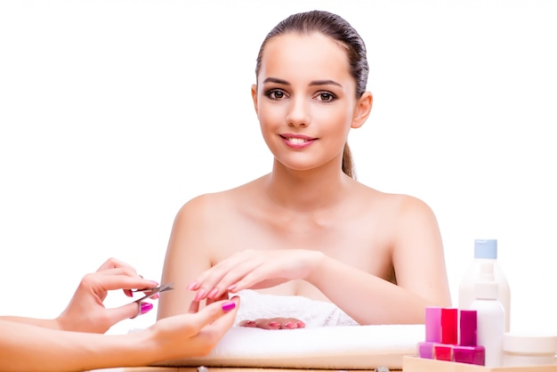 Woman in hand treatment manicure