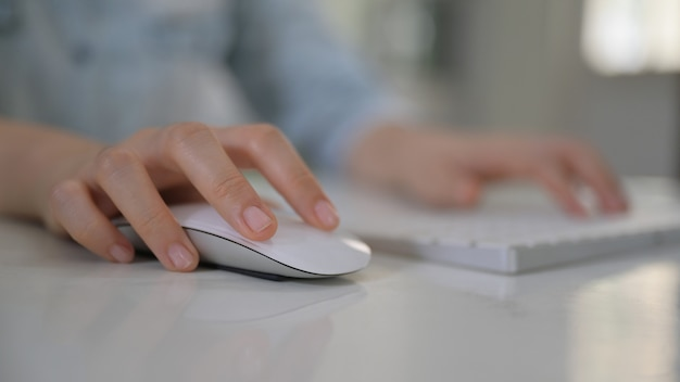 Woman hand using mouse and computer keyboard.